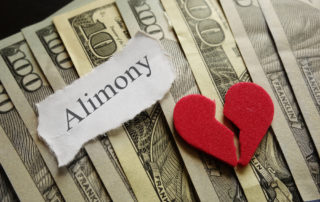Broken red heart and Amimony paper note on cash